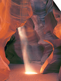 Sunbeam Illuminates Sandy Floor and Sandstone Walls of a Slot Canyon, Antelope Canyon, Page Posters by Dennis Flaherty