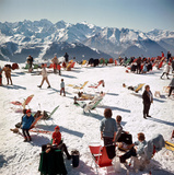 Holiday-makers take the sun on a mountain top in Verbier, 1964. Premium Photographic Print by Slim Aarons