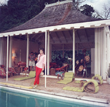 Babe Paley by the pool. Her husband, William Paley is snapping the photographer at their cottage. Premium Photographic Print by Slim Aarons