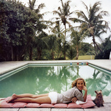 Socialite Alice Topping relaxing at a poolside in Palm Beach. Premium Photographic Print by Slim Aarons