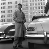 circa 1955: Film star Farley Granger (Farley Earle II) outside the Plaza Hotel, New York. Premium Photographic Print by Slim Aarons