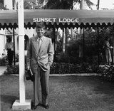 Democratic senator for Massachusetts, John Fitzgerald Kennedy outside Sunset Lodge. Premium Photographic Print by Slim Aarons