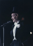 1959: In top hat and tails Marlene Dietrich performs at an 'April in Paris' ball in New York. Premium Photographic Print by Slim Aarons