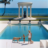 C.Z. Guest and her son Alexander Michael Douglas Dudley Guest in front of their Grecian temple pool Premium Photographic Print by Slim Aarons