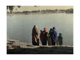 A Family Stands on the Stone Shoreline of the Sacred Lake, Pushkar Photographic Print by Gervais Courtellemont