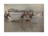 Life Guards of the Beach Patrol Push a Boat into the Water Photographic Print by Clifton R. Adams