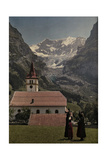 Women Talk in a Field in Front of a Church at the Foot of the Glacier Photographic Print by Hans Hildenbrand