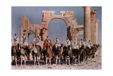 Natives Lines Up their Camels to Ride before the Gateway at Palmyra Photographic Print by W. Robert Moore