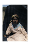 A Crow Indian Child Wears a Buckskin Dress of Beads and Teeth Photographic Print by Edwin L. Wisherd