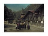 A Group of Mothers and Daughters Pose on a Village Street Corner Photographic Print by Hans Hildenbrand