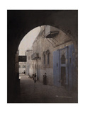 A View Through an Archway of a Street in the Jewish Quarter Photographic Print by Gervais Courtellemont