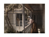Two Women Look on to the Courtyard from a Balcony of a Christian Home Photographic Print by Gervais Courtellemont