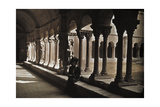 A Woman Sits under a Covered Walkway of Columns Photographic Print by Franklin Price Knott