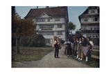 A Herdsman Poses with a Group of Young Women in a Herisau Street Photographic Print by Hans Hildenbrand