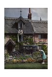A Woman Tends Her Garden Outside Her Cottage in Horning-On-The-Bure Photographic Print by Clifton R. Adams
