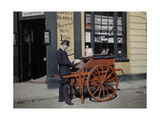 A Postman Delivers Packages with His Parcel Post Barrow Photographic Print by Clifton R. Adams