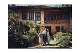 Three Women in Traditional Serbian Clothing in Front of their Home Photographic Print by Hans Hildenbrand