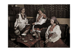 Traditionally Dressed Women Visit in Home Decorated in National Style Fotografiskt tryck av Wilhelm Tobien