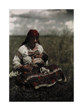 A Gypsy Woman Nurses Her Child Photographic Print by Hans Hildenbrand