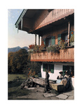 Women Sit Outside their Tegernsee Farmhouse Photographic Print by Hans Hildenbrand
