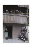 A Peasant Family Outside of their Wooden House Photographic Print by Hans Hildenbrand