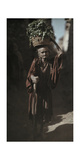An Elderly Woman Carries Food in a Basket Through Town Photographic Print by Franklin Price Knott