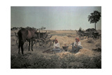 Two Women Rest in a Field During Harvest Photographic Print by Hans Hildenbrand