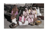 A Group of Indian Women Await to Embark on their Journey Home Photographic Print by Melville Chater