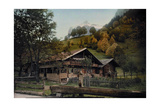 A Log Cabin Sits at the Foot of a Mountain in Bernese Oberland Photographic Print by Hans Hildenbrand