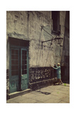 A Woman Touches the Wall of the Municipal Building for the Cabildo Photographic Print by Edwin L. Wisherd