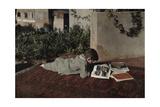 A Boy Reads a National Geographic Magazine While Lying on His Stomach Photographic Print by Maynard Owen Williams