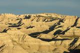 A Vast, Forbidding Badlands Landscape in Warm Sunlight Photographic Print by Sergio Pitamitz