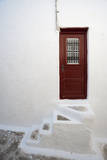A Red Door Leading into the White-Washed Panagia Tourliani Monastery Photographic Print by Sergio Pitamitz