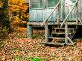 Wooden Stairs Up to a Cabin in a Forest of Trees in Autumn Hues Photographic Print by Babak Tafreshi