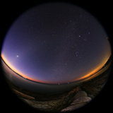 Fisheye of Morning Twilight, Zodiacal Light, Venus, the Milky Way, Jupiter, and City Lights Photographic Print by Babak Tafreshi