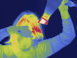 Thermal Image of a Woman Blow Drying Her Hair Photographic Print by Tyrone Turner