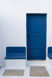 A White-Washed Building with a Bright Blue Door and Benches Photographic Print by Sergio Pitamitz