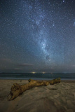 The Milky Way Above Itamambuca Beach at Night and Ship Lights on the Horizon Photographic Print by Alex Saberi