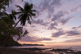 A Palm Tree-Lined Beach with Gentle Surf at Sunset Photographic Print by Sergio Pitamitz