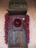 An Old Wooden Door Decorated with a Wreath a Ristras of Dried Chile Peppers Photographic Print by Diane Cook Len Jenshel