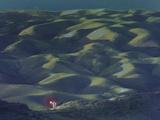 A Lone Traveler in the Hills of Judea Near Jebel Qarantal Photographic Print by Thomas Nebbia