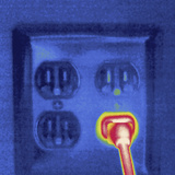 Thermal Image of a Plug in a Socket Photographic Print by Tyrone Turner