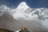 A Climbing Team Stand Looking Up at Ama Dablam in the Everest Region of Nepal Photographic Print by Alex Treadway