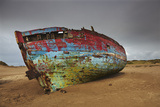A Wrecked Boat Lying Among Sand Dunes Photographic Print by Nigel Hicks