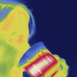 Thermal Image of a Woman Drinking from a Mug Photographic Print by Tyrone Turner