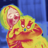 Thermal Image of a 9 Year Old Girl Holding Her Pet Cat Photographic Print by Tyrone Turner