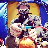 An Everest Expedition Member Uses Oxygen for Safety Photographic Print by Andy Bardon
