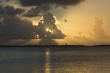 Sun Rays Filter Through Dramatic Clouds over the Ahe Atoll at Sunset Photographic Print by Andy Bardon