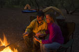 Two People Enjoy a Fire While Camping at First Landing State Park, Virginia Beach, Virginia Photographic Print by Joel Sartore