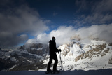 A Skier in the Italian Dolomites Prepares to Make His Way around the Sellaronda Photographic Print by Alex Treadway